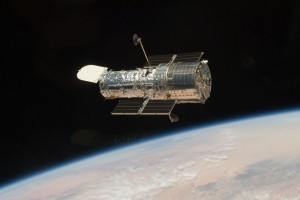 HST after repaired as seen from the Atlantis shuttle (credit NASA)