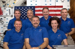 In-orbit portrait of the crew taken during the rest day after the service mission was completed.