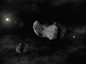 Artist rendering of the triple system: Romulus, Sylvia, and Remus. This is the first triple asteroid system discovered - two small asteroids orbiting a larger one known since 1866 as 87 Sylvia. Because 87 Sylvia was named after Rhea Sylvia, the mythical mother of the founders of Rome, the twin moons are named after those founders: Romulus and Remus. Sylvia's moons are considerably smaller, orbiting in nearly circular orbits and in the same plane and direction.  (ESO PR)