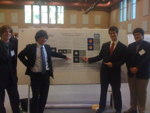 The HMC students in front of their poster