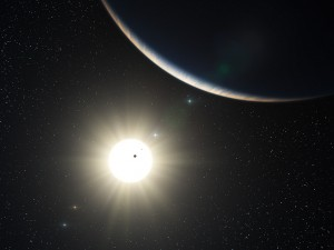 This artist's impression shows the remarkable planetary system around the Sun-like star HD 10180. The large crescent is the third world in the system (HD 10180d), which is comparable to the planet Neptune in mass. The two inner planets appear as silhouettes in transit across the bright disc of the star. The outer planets in the system appear in the background sky.(Credit ESO)