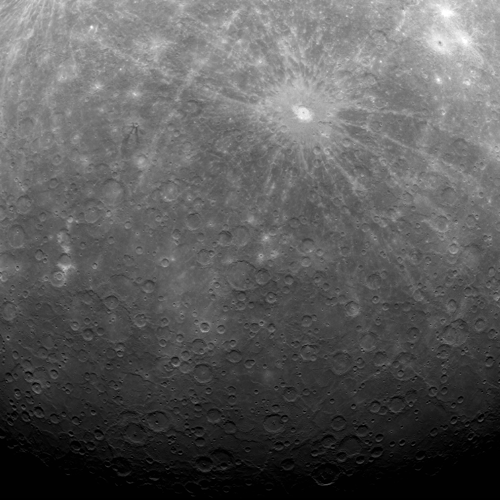 First image of Mercury taken with the Messenger Orbiter showing the Debussy crater near the south pole of Mercury.  This image was recorded with the Wide Angle Camera (WAC) of the Mercury Dual Imaging System (MDIS) at a center latitude of -53.3° and a center longitude of 13.0° E with a resolution of 2.7 kilometers/pixel (credit: JHU-APL, NASA, Carnegie)
