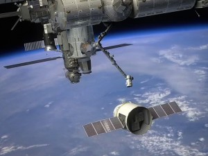 Dragon approaching International Space Station. Courtesy NASA